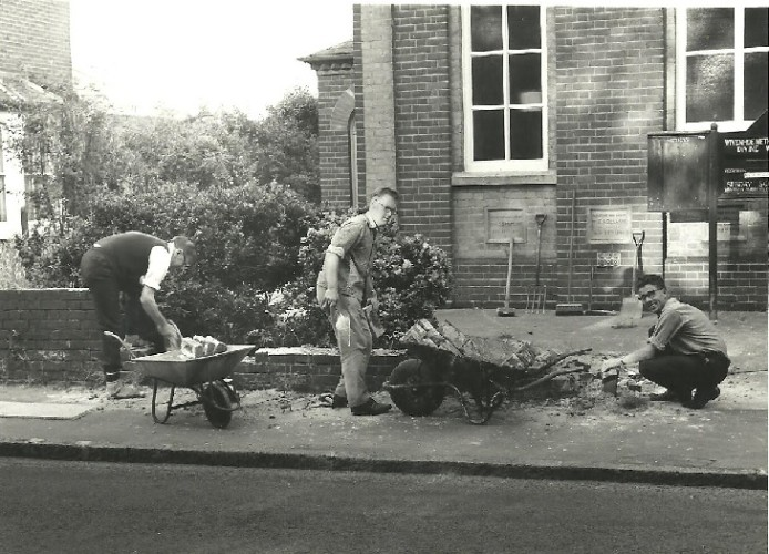 Mr Sweeting and two others working on the wall in front of the Methodist Church probably in the 1960s. Mr Sweeting was Surveyor and Public Health Inspector of Wivenhoe Urban District Council at that time.