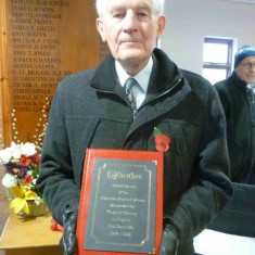 Ian Valentine holding the The Roll of Honour before walking it down to St Mary's Church in November 2016 in the Royal British Legion procession from the Congregational Church.