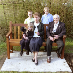 Pat Green and her grandchildren with George Atkinson, Chairman of WAGA, at the presentation of a bench in memory of Maurice Green. | Photo by Peter Hill