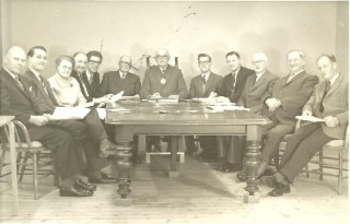 1967 Wivenhoe Urban District Council L – R:  Cllr. Ted Westlake, Cllr.Terry Endean, Cllr. Miss B.A. Grasby, Cllr.  Bill Cracknell, Assistant Clerk Albert Manning, Cllr. Percy Chaney, Cllr. William Loveless, Mr. D.F. Sweeting, Surveyor and Public Health Inspector, Walter Trickett Clerk to the Council, Cllr. D. Bull, Cllr. G. J. James, Cllr. Leslie Kemble.