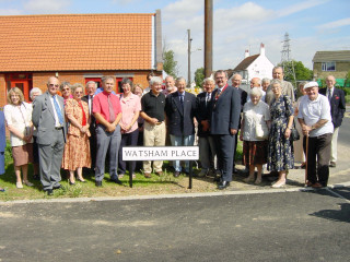 Local Councillors, friends of the Watshams and members of the Bowls Club came to celebrate the naming of the new road Watsham Place  | Photo: Bonnie Hill