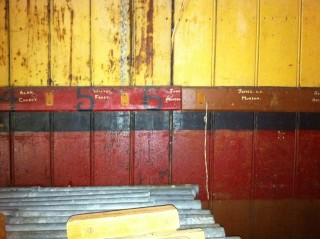Inside the building with names still visible against the pegs which have been removed | Photo by Toni Stinson