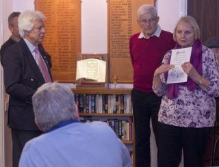 Deputy Chairman Gill Strudwick showing one of the paperback copies of the Roll of Honour in which people can read all of the names and the branch of the Services into which they enlisted.  | Photo by Frances Belsham