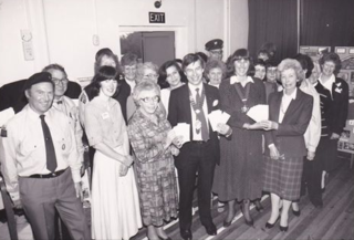 Cllr Peter Hill, Wivenhoe Town Mayor with Mayoress Bonnie Hill, giving out cheques to 20 organisations from the Mayor's Charity Fund in April 1988   Photographer, Tony Ellis, Essex County Standard