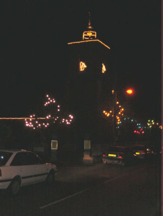 The lights on St Mary's Church Tower and with cupola all lit up too. | Photo by Peter Hill
