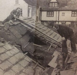 Builders Andy Anderson and Stephen Williams, of Westbrook and Son, inspect the damaged tiles of the Rose and Crown, Wivenhoe. | Laurie Honeyball, Roger Tamblyn, and Tony Tasker, Photographic Team, Essex County Standard