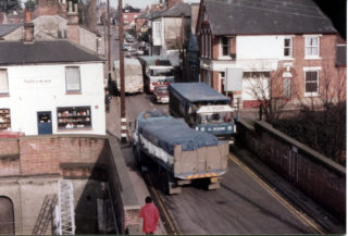 Heavy traffic to and from Wivenhoe Port in the1980s in The High Street and across the Railway Bridge | Photo Mike Downes