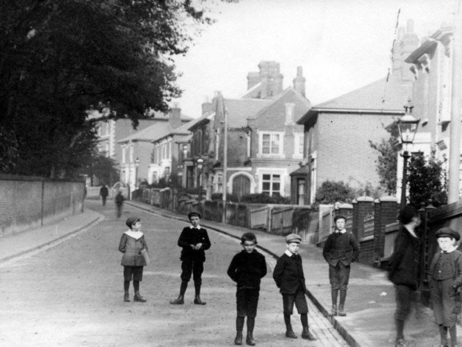 Photo of the High Street showing the National School (now the site of the library) | Wivenhoe Memories Collection