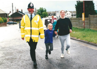PC Sid Cox completing the Wivenhoe Mile fun run, part of Wivenhoe Carnival, in 1995 | Photo by Sue Murray ARPS