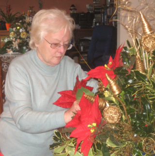 Sylvia in charge of Christmas decorations at St Mary's Church  | Photo by Peter Hilll
