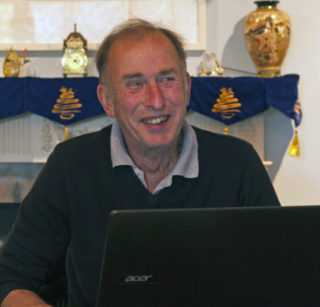 John Stewart working on the Wivenhoe History web site   | Photo by Frances Belsham