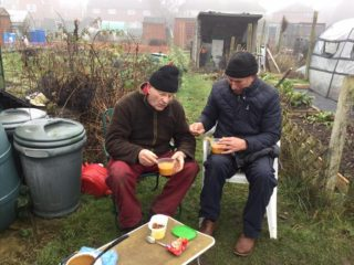 John Stewart sharing a meal with his great friend Fred Purdey at their allotments