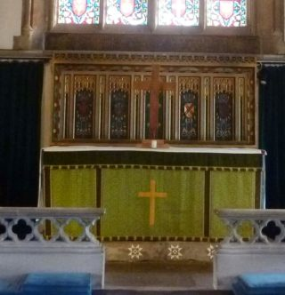 The Altar at St Mary's decorated with a simple wooden cross made by Colin Oliver | Photo: Peter Hill