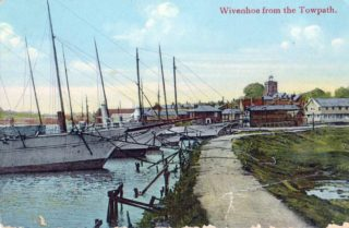 Steam yachts laid up against the sea wall for the winter in their soft mud berths | Wivenhoe Memories Collection