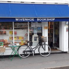 Sue Finn, owner of the Wivenhoe Bookshop, once the cycle repair shop run by David Bones, got into the swing of the day. | Peter Hill