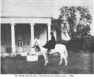 The Rev. Clementina M. Gordon B.D. on her horse in the grounds of the Manse  | Copied from a booklet about the Congregational Church by the Rev. Clementina M. Gordon B.D. published in 1966