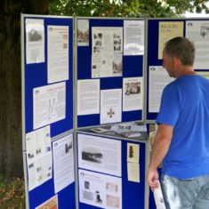 A High Street resident reading information on the History Group's display stand in the churchyard. | Dick Polom