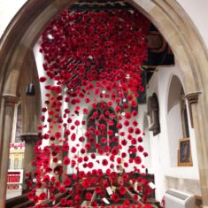 Hundreds of knitted poppies made by lots of Wivenhoe people decorated each side of the chancel | Peter Hill