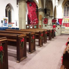 The interior of St Mary's Church showing pew ends decorated by Wivenhoe Quay Quilters