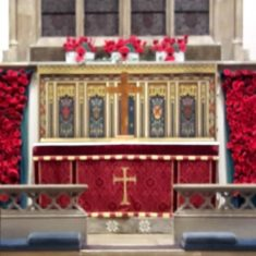 The altar of St Mary's Church Wivenhoe decorated with poppies made by members of Wivenhoe's W.I. | Peter Hill