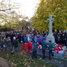 Members of the many Wivenhoe Scout and Guide groups laying crosses on the War Memorial | Peter Hill