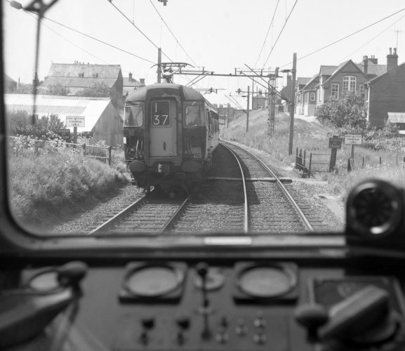 View out of the cab window of the train taken as it passes the Paget Road railway crossing. | Source unknown