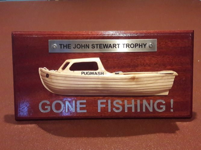 The John Stewart 'Gone Fishing' Memorial Trophy designed by Ron Williams and carved by Cllr Bob Needham.