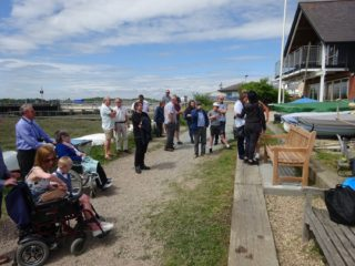 A small group of friends and family gathered outside Wivenhoe Sailing Club for the unveiling of the bench in memory of John Stewart | Peter Hill
