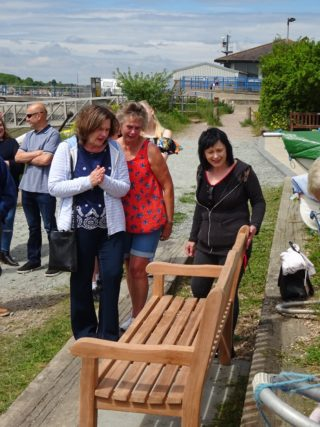 John Stewart's three sisters Chrissy, Carol and Elaine look at John's Memorial Bench for the first time. | Peter Hill