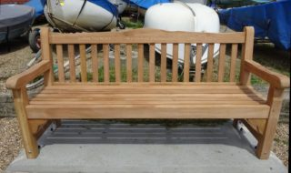 John Stewart's Memorial Bench outside the Wivenhoe Sailing Club with the inscription John Stewart ~ Wivenhoe Historian ~ 1947 - 2018   Peter Hill