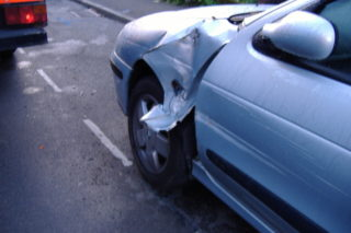 Car damaged by passing plant machinery attempting to reach Cooks Shipyard via Queens Road 2006   QRRA