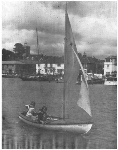 Sea Scout Leader Gerry Peterson sailing in a dinghy owned by 3rd Wivenhoe Sea Scouts with Sea Scout Stuart Meyers | Photo by Wivenhoe Photoprapher Les Stockdale and published by Essex Countryside magazine November 1979
