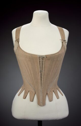 An example of a stay made in the 1780s comprised of linen, hand sewn with linen thread, applied ribbon, chamois and whalebone | (c) Victoria & Albert Museum, London [T173-1914]