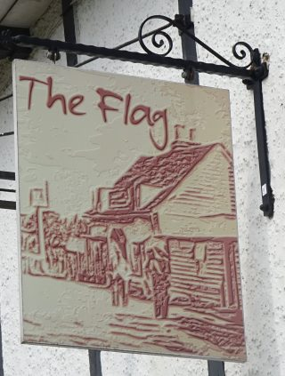 The sign for The Flag PH in Colchester Road, Wivenhoe in 2020 | Peter Hill