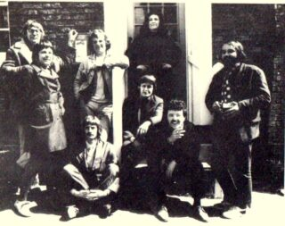 Artists outside The Black Buoy. Standing from left to right: Michael Heard, Pam Dan, John Mead, Gail Cross and Tony Young. Sitting: Alan Taylor, Roy Cross and John Dan | Taken from Nick Butler's book, The Story of Wivenhoe
