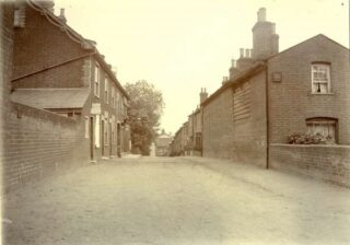 Queens Road looking east with The Anglesea Arms on the right. | Photo:  John Leather Collection