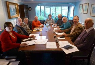 A meeting of the trustees of the Wivenhoe Housing Trust in November 2013 at Toad Hall. LtoR: Clare Heyes, PA to the Clerk, Michael Siggs, Clerk to the Charity, Charles Scofield, Karl Douzier, Anne Horner, Clive Jennings, Janet Turner, Bob Needham, and Tony Forsgate | Photo by Peter Hill