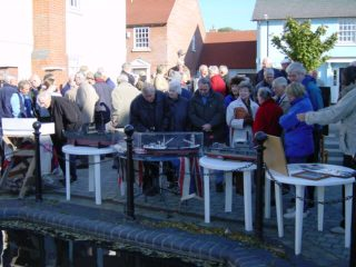 Guests at the unveiling, who included Tom Dale from Persimmon Homes who supervised the construction of the homes, admiring scale models of ships built at the Wivenhoe Shipyard and crafted by local resident Bill Ellis.