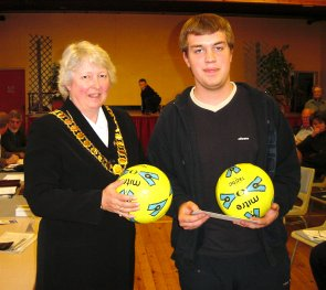 Town Mayor, Cllr Gilli Primrose, gave a cheque and two footballs to Joseph Slater for use on KGV Playing Fields | Peter Hill