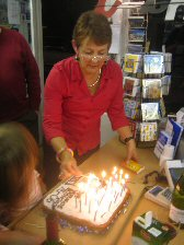 Proprieter Ginny Waters lights a birthday cake | Peter Hill