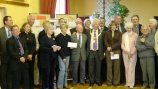 Cllr Peter Hill, Town Mayor 2004 - 2005 with all of the recipients of cheques from the Mayor's Charity Fund